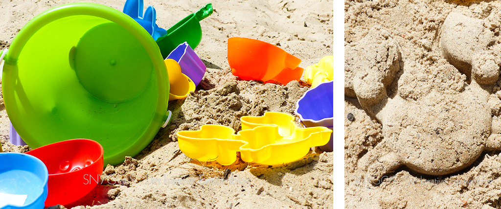 Im Sand spielen