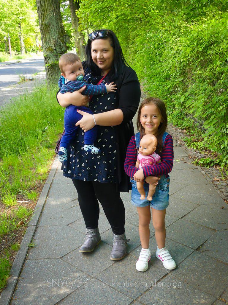 Die-Babys-auf-dem-Arm